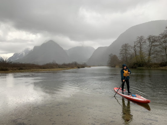 A single person on a paddleboard on Widgeon Creek, BC.