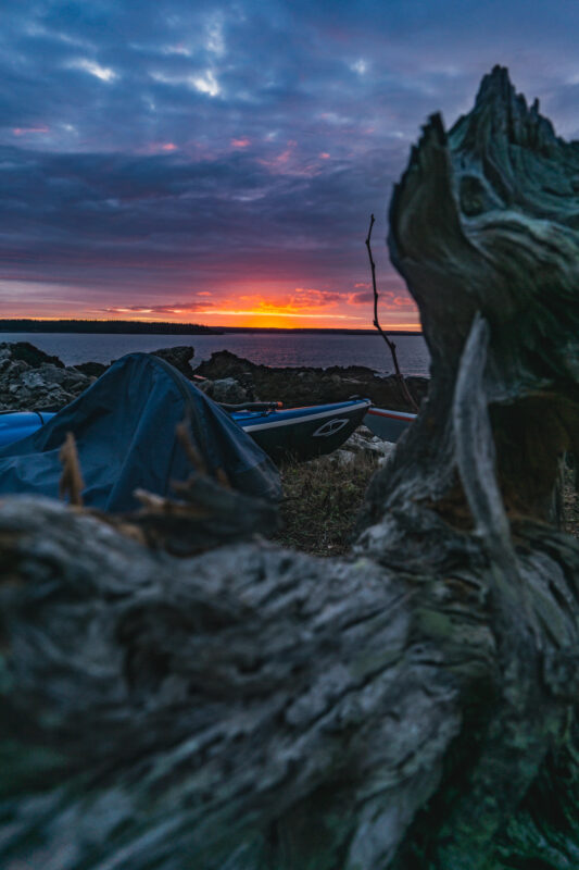 Kayak camping and tent with a sunset.