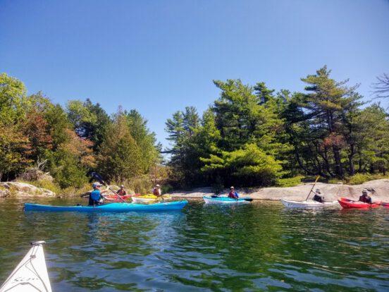 Ray Boucher teaching sea kayaking in Georgian Bay, Ontario to some adults.