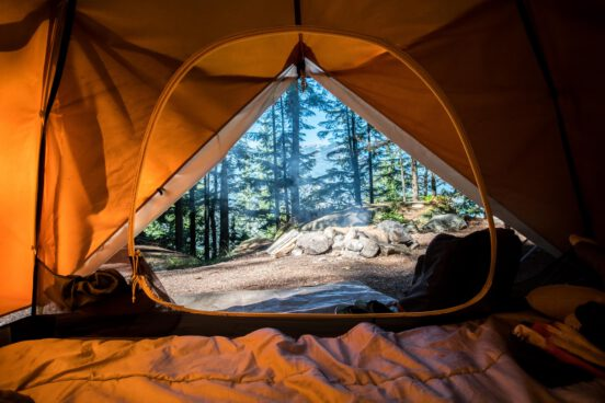 A photo of a camping tent out the front door.