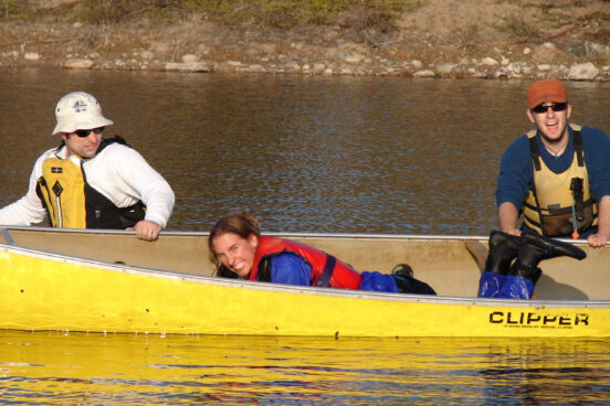 Students having fun in a canoe during a canoe course on the Hay River Pond, NWT.