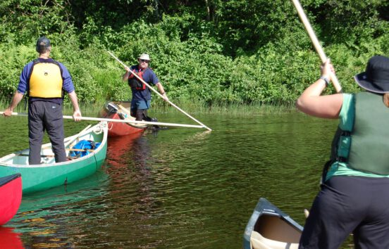 A student learning intermediate canoe poling techniques on the Hammond River, NB with Tim Humes.