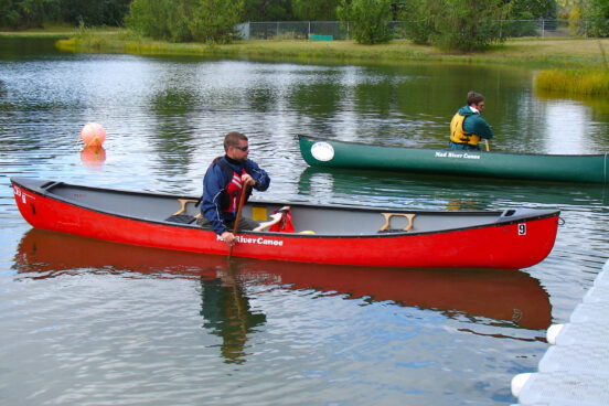 A student practices his solo canoeing during a course in Lake Hermitage, Alberta.