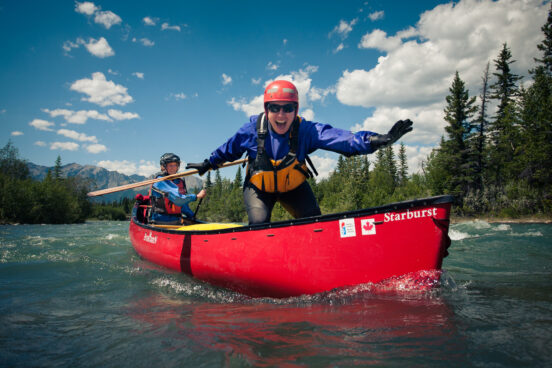 Students having fun on a moving water canoe course on the Kananaskis River, AB.