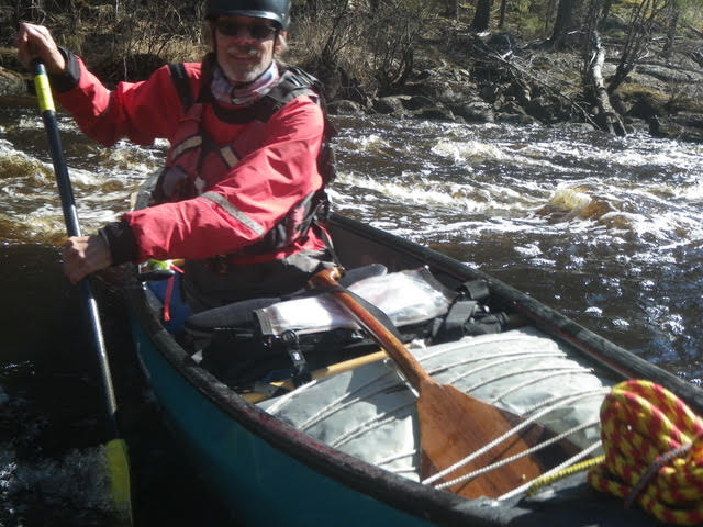 Brian in a white water canoe